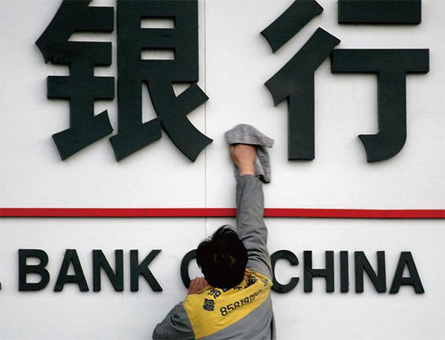 IMF:中國金融三隱患恐致經濟崩盤
